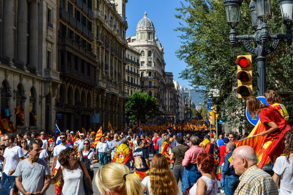 Thousands of people on street celebrate the football ...